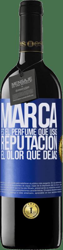 24,95 € Envío gratis | Vino Tinto Edición RED Crianza 6 Meses Marca es el perfume que usas. Reputación, el olor que dejas Etiqueta Azul. Etiqueta personalizable Crianza en barrica de roble 6 Meses Cosecha 2018 Tempranillo